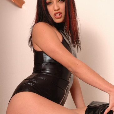 Deja Dare in black vinyl outfit