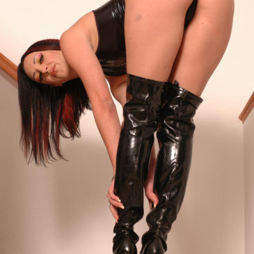 Deja Dare in black leather boots