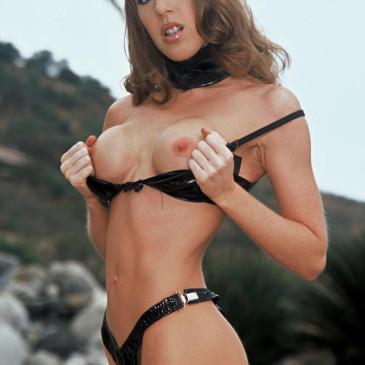 Brunette flashing her boobs outdoors