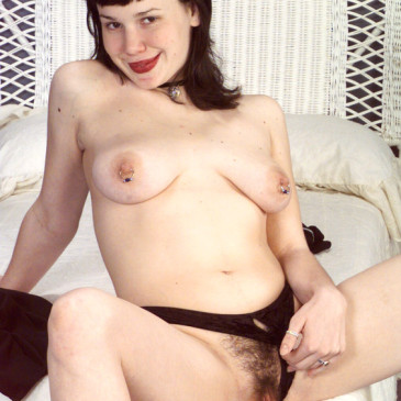 Goth chick shows her bushy pussy